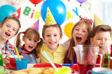 kids birthday party: Group of adorable kids looking at camera at birthday party