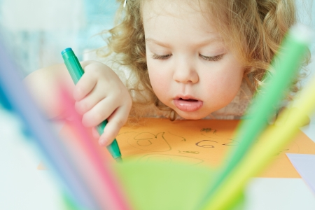 absorbed: Close-up shot of an adorable little girl being absorbed in drawing Stock Photo