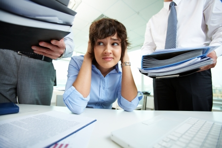 Office lady being scared because of too much paperwork to do