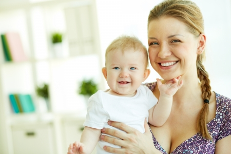Family of happy mother and daughter laughing while looking at camera Stock Photo - 19170129