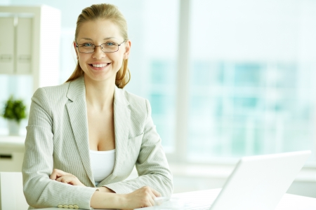 Portrait of successful businesswoman looking at camera with smile Stock Photo - 19170125