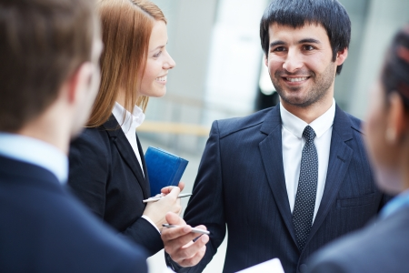 Group of business partners negotiating at meeting, focus on smart man Stock Photo - 19170139