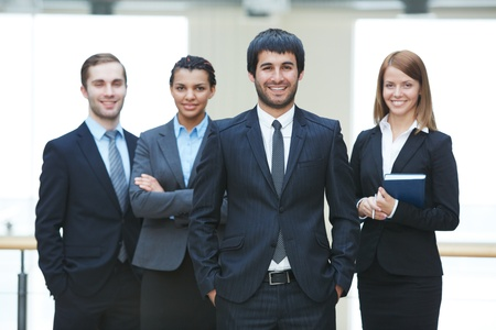 Group of friendly businesspeople with male leader in front Stock Photo - 19170162