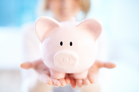 Image of pink piggy bank on human palms Stock Photo - 19704868