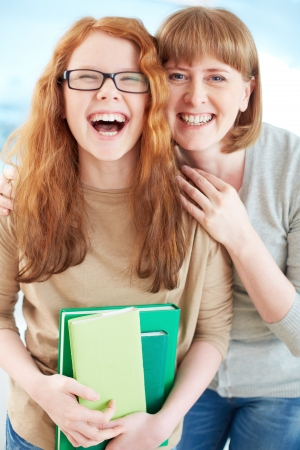 teenagers laughing: Lovely girl and her mother laughing