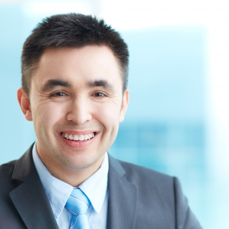 Portrait of cheerful businessman looking at camera with smile photo