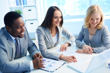 corporate training: Team of three considering optimal business solution