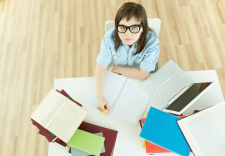 Image of an excellent female student sitting at desk  photo