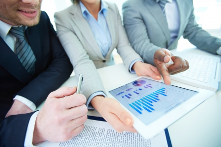 Image of human hands during discussion of business document in touchscreen at meeting Stock Photo - 19670832