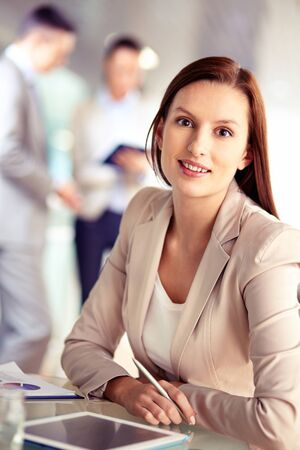 pepsico: Portrait of friendly specialist looking at camera on the background of working colleagues