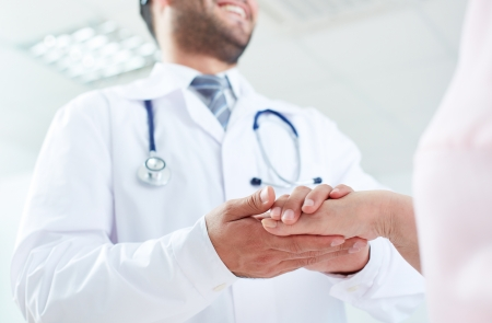man doctor: Image of doctor and senior patient hands Stock Photo