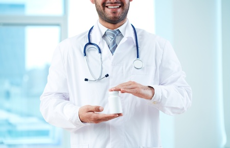 holding close: Close-up of doctor holding new medicine