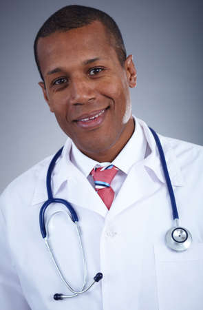 Confident doctor in uniform with stethoscope looking at camera photo