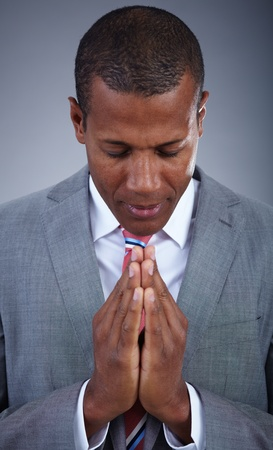 Smart businessman praying with his eyes closed photo