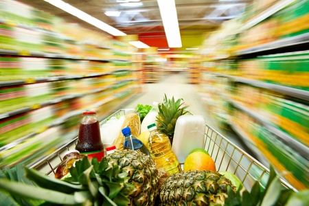 health food store: Image of cart full of products in supermarket Stock Photo