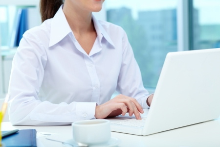 Close-up of female typing on laptop Stock Photo - 19786634