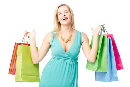 shopaholism: Portrait of happy female with colorful paperbags looking at camera