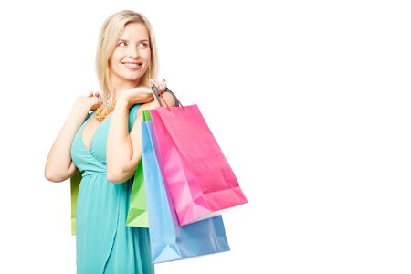 shopaholism: Portrait of happy female satisfied with her lucky shopping over white background Stock Photo