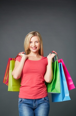 Portrait of happy female with colorful paperbags in isolation Stock Photo - 19787426