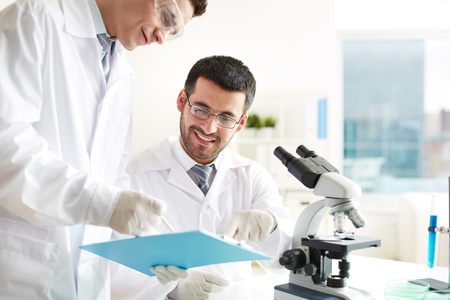 chemical laboratory: Two clinicians discussing medical document in laboratory