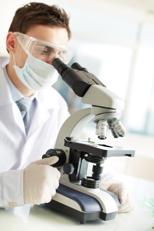 clinician: Serious clinician studying chemical element in laboratory