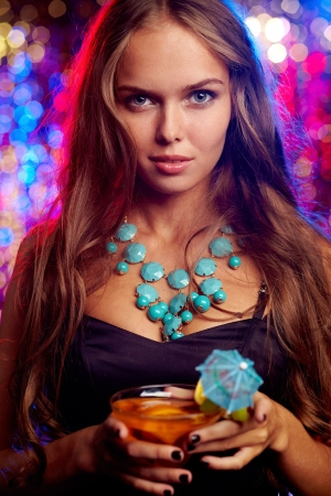necklace: Image of pretty girl with cocktail in the night club