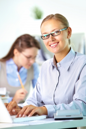 Portrait of pretty secretary looking at camera while working Stock Photo - 19786717