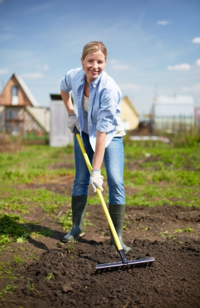 Image of happy female farmer working in the garden photo