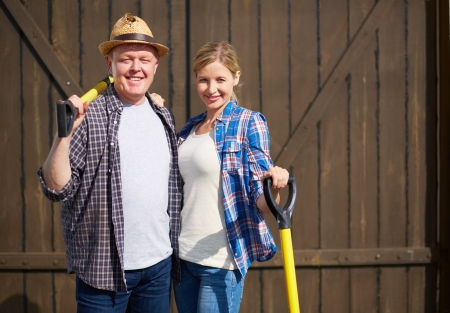 Image of two happy farmers with instruments photo