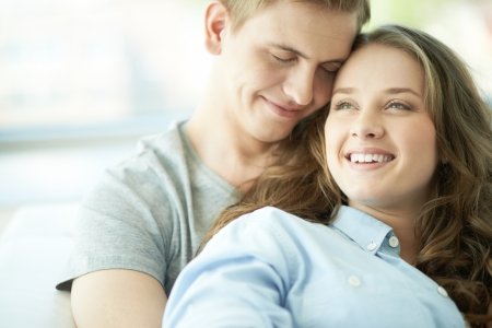 Portrait of amorous young couple enjoying rest photo