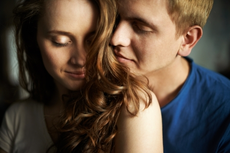 smell: Young man enjoying smell of hair of his sweetheart
