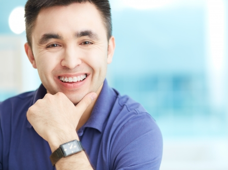 Portrait of cheerful businessman looking at camera with smile Imagens