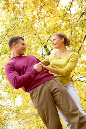Happy couple on background of yellow leaves  photo