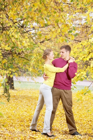 Happy couple embracing in autumnal park  photo