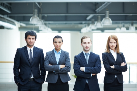 Group of friendly businesspeople in suits standing in line Stock Photo - 20134522