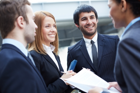 competitive business: Group of business partners negotiating Stock Photo