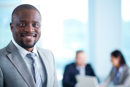 woman boss: Image of African-American business leader looking at camera in working environment Stock Photo