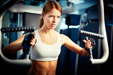 Portrait of young female training in gym photo