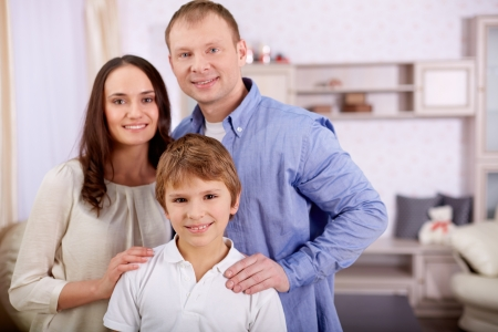 Portrait of happy lad and his parents looking at camera at home Stock Photo - 20258994
