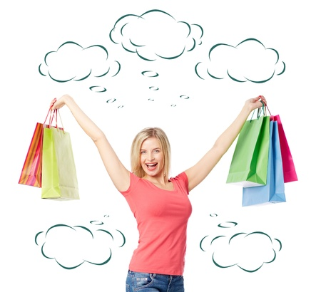 shopaholism: Portrait of happy female raising arms with colorful paperbags over white background Stock Photo