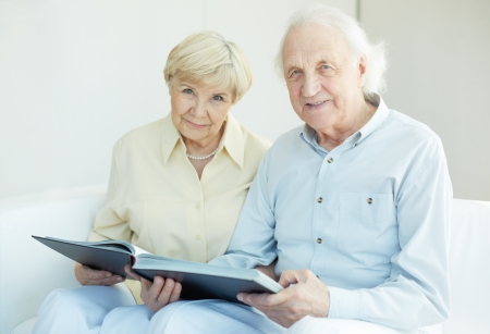 an elderly couple: Portrait of a candid senior couple looking at camera at leisure
