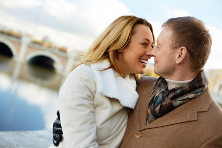 inlove: Portrait of affectionate couple having good time outside