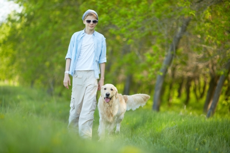lad: Portrait of cute lad and his fluffy friend walking outdoors