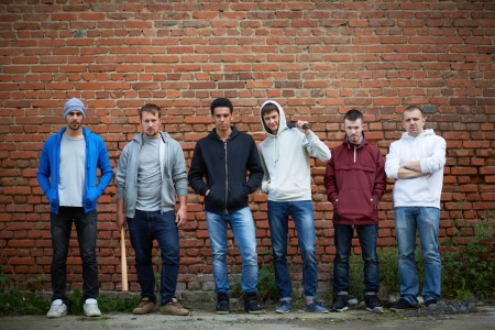 teenagers standing: Portrait of several street hooligans or rappers    Stock Photo