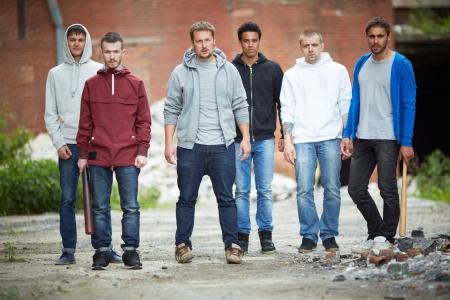 spiteful: Portrait of spiteful guys on the street