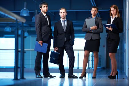 Group of friendly businesspeople in suits standing in line in office building Stock Photo - 20519144