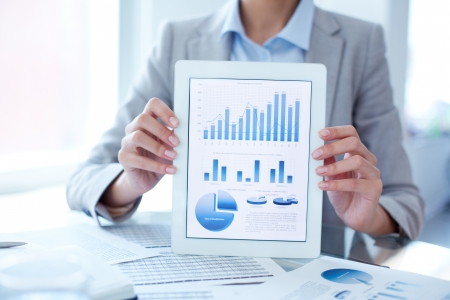 Close-up of businesswoman presenting financial solution in touchpad photo