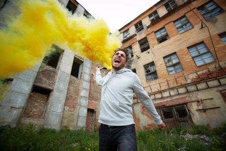 spiteful: Portrait of furious dude with smoking detonator tube