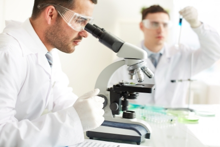 protective spectacles: Serious clinicians studying chemical elements in laboratory