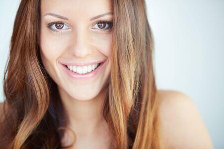 expression facial: Close-up of happy woman looking at camera